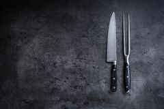 Fork and knife. Fork and knife on concrete board Stock Photography