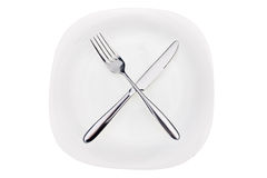 Fork and knife on a dish Royalty Free Stock Photo