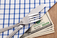 Fork and knife on dollar bills Royalty Free Stock Photo