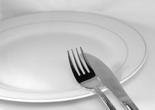 Fork, knife and empty plate. In a table royalty free stock photos