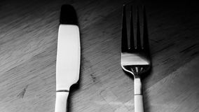 Fork and knife. On the kitchen stock images