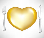 Fork and knife with golden heart Stock Photo