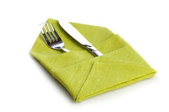 Fork and knife in green cloth Stock Image