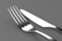 Fork and knife on grey Royalty Free Stock Photo