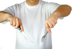 Fork and knife in hands Royalty Free Stock Photo