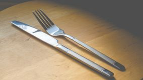 Fork and knife. On the kitchen stock photo