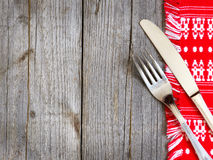 Fork and knife on kitchen towel Stock Photography