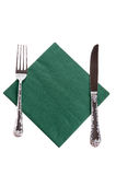 Fork and a knife lying on napkin Stock Image
