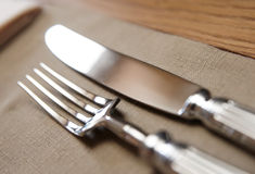 Fork, knife and napkin Stock Photo