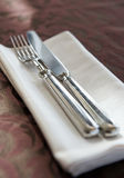 Fork, knife and napkin Stock Image