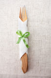 Fork and a knife in the napkin on a linen material Stock Photography
