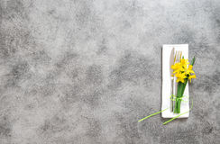 Fork knife napkin on table plate spring flowers Stock Image