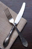 Fork, knife and napkin on table Royalty Free Stock Photography