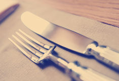 Fork, knife and napkin, toned Royalty Free Stock Photography