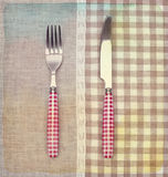 Fork and knife on napkin. Vintage retro style. Royalty Free Stock Image