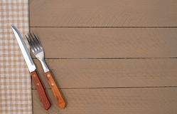 Fork Knife and Napkin on Wooden Background Stock Photo