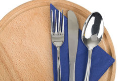 Fork with knife, and napkin. On wooden table Stock Photography