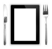 Fork with a knife near the tablet computer. edible tablet comput. Er Royalty Free Stock Photo