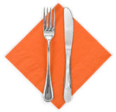 Fork and knife in a orange cloth Stock Photos