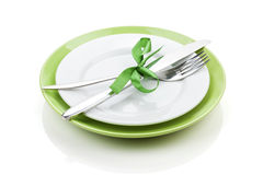 Fork with knife over blank plates Royalty Free Stock Photos