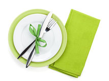 Fork with knife over towel and empty plates Royalty Free Stock Photo