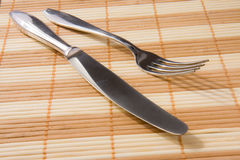Fork and knife on placemat Stock Photo