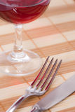 Fork and knife on placemat Royalty Free Stock Photography