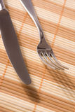 Fork and knife on placemat Royalty Free Stock Photos