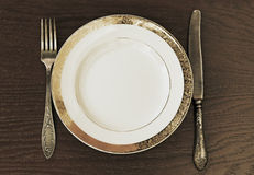 Fork, knife and plate. Antique fork, knife and plate royalty free stock photography