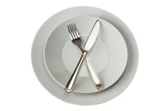 Fork And Knife on Plate Stock Images