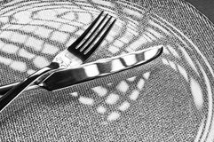 Fork and knife on a plate Royalty Free Stock Photos