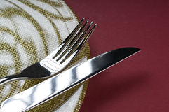 Fork and knife on a plate Royalty Free Stock Image