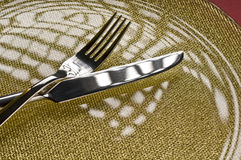 Fork and knife on a plate Royalty Free Stock Photography