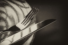 Fork and knife on a plate Stock Image
