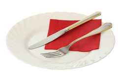 Fork and knife on a plate Royalty Free Stock Photo