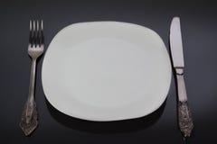 Fork, knife, plate. Stock Image