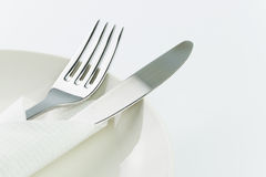Fork and knife on plate Stock Photography