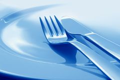 Fork and knife on plate Royalty Free Stock Image