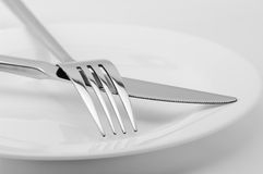 Fork, knife and plate close-up Stock Images