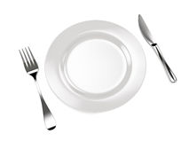 Fork with knife and plate Royalty Free Stock Photos