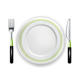 Fork and knife with plate isolated on white Stock Photos