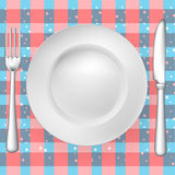 Fork, knife and plate on pattern Stock Photography