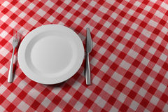 Fork Knife and Plate on a red table cloth Stock Photography