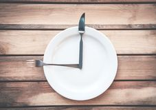 Fork with knife and plate on the table. Time to eat. Royalty Free Stock Photo
