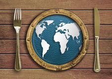 Fork, knife and porthole with world map concept Stock Photos