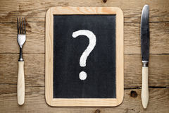 Fork and knife and question mark Royalty Free Stock Images