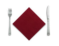 Fork and knife in a red cloth isolated on white. Background Stock Photography