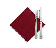 Fork and knife in a red cloth isolated on white. Background Stock Photos