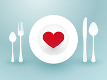 Fork knife and a red heart Stock Images