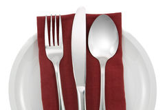 Fork and knife on red napkin isolated Stock Images